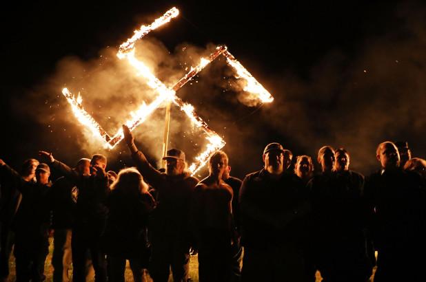 Small Group Of Neo-Nazis Burn 18-Foot Swatiskas After Georgia Rally