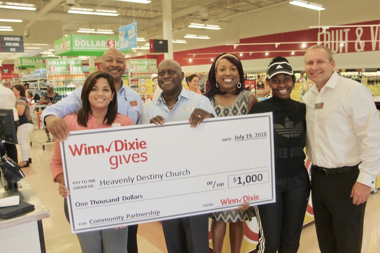 COMMUNITY PARTNER PRESENTED $1,000 CHECK