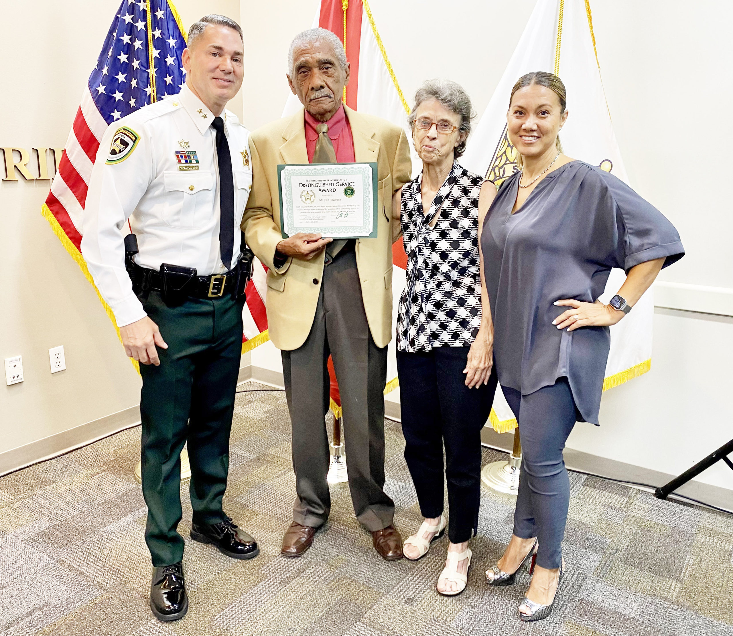 SHERIFF PRESENTS DISTINGUISHED SERVICE AWARD TO HONORARY MEMBER